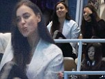 Forget Shayk-ing it... she's waving it! Model Irina throws her arms in the air and shouts as she supports footballer boyfriend Cristiano Ronaldo at Real Madrid match