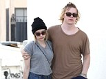 He doesn't care: Evan Peters fails to impress in the style stakes as he and fiancée Emma Roberts grab a bite