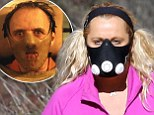 Biggest Loser's Ajay Rochester shows off slimmed down figure in spandex leggings while on a rigorous hike... but what's with the Hannibal Lector mask?