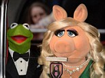 Here they come: Kermit The Frog and Miss Piggy arrive in Mayfair for the premiere of Muppet's Most Wanted at the Curzon on Monday