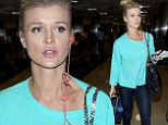 Joanna Krupa shows off her long legs in tight skinny jeans as she makes a cool arrival into Los Angeles