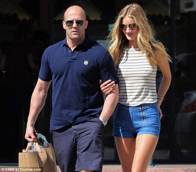 Complementary couple: Both the action man and his model love had the idea of wearing shorts for their excursion, with Rosie completing her look with a white striped tank and sandals, while her beau opted for a navy blue polo shirt and white sneakers