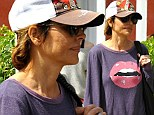Pucker up! Lisa Rinna goes make-up free as she shows off her huge plumped lips ... adorned across her shirt
