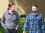 Matching hairdos: Bruce and Brandon Jenner sported matching ponytails as they brunched together in  Westlake, California