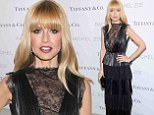 Rachel Zoe takes the plunge in daring cleavage baring gown at New York launch of her second book