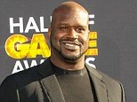 V for victory: But it remains to be seen whether Shaquille O'Neal will emerged from his assault investigation unscathed