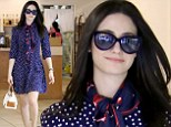 Nothing to be ashamed of! Emmy Rossum looks chic in a navy polka dot dress and a scarf wrapped around her neck in LA