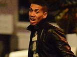 Out and about: Chris Smalling is pictured in the early hours of Saturday morning leaving a bar