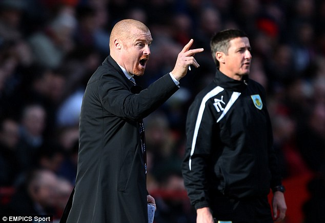 Living the dream: Dyche is nine games away from taking Burnley to the Premier League