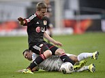 Wanted man: Arsenal are hoping to sign Bayer Leverkusen midfielder Lars Bender (top) this summer