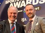 Top of the pile: Head of Sport Lee Clayton (right) picks up the award on Monday night