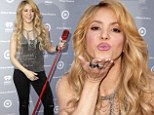 Lips don't lie! Shakira blows a kiss as she hams it up on the red carpet at album launch
