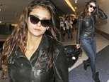 Jet-set Diaries: Nina Dobrev leaves her locks wavy as she flies out of LA after just two days in leather jacket and skinnies