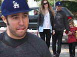 Back home: Pete Wentz spent time with girlfriend Meagan Camper and son Bronx on Monday after returning from a trip to Europe