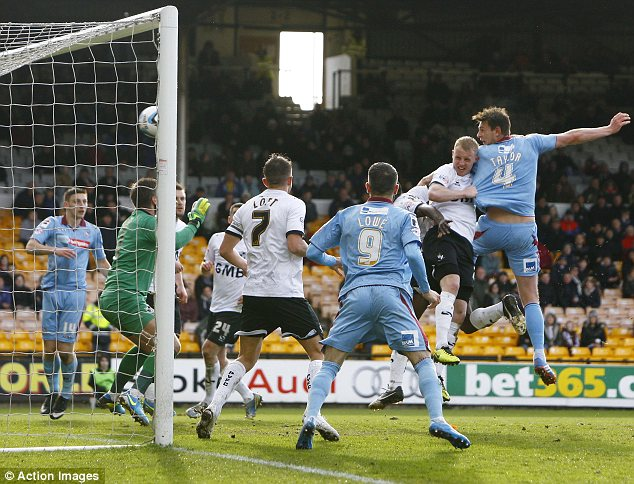 Heads  up: Ash Taylor scores the first goal for Tranmere Rovers at Port Vale