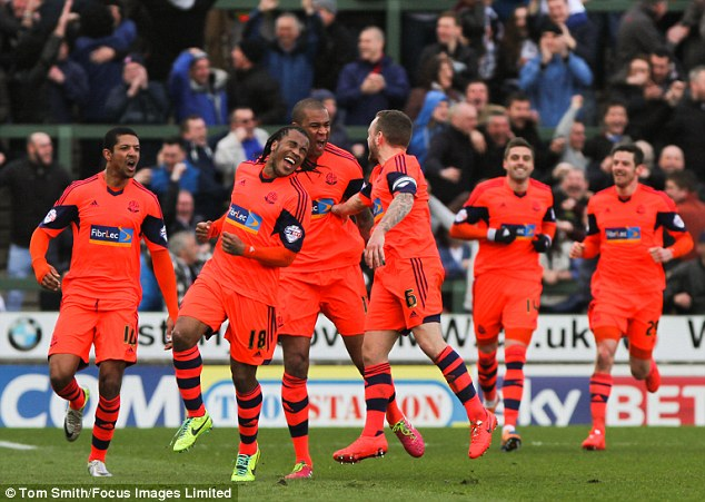 Late equaliser: Zat Knight (centre) is mobbed by team-mates after scoring a late goal for Bolton