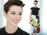 Fresh-faced Anne Hathaway playfully sports a flower in her hair and dons a colourful skirt at Rio 2 press conference in Miami