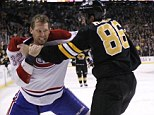 Brawlers: Boston Bruins ice hockey star Kevan Miller (right) goes toe-to-toe with Montreal Canadiens left wing Travis Moen during the NHL game in Massachusetts