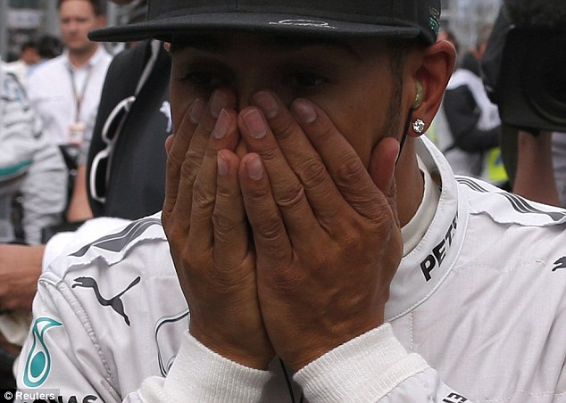 Staying strong: Hamilton, who started from pole, remains upbeat despite his troubles in Melbourne