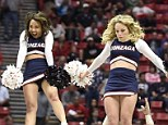 Leap of faith: Gonzaga cheerleaders perform as the team plays Arizona during the second half of a third-round game in the NCAA college basketball tournament in San Diego