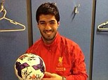 Smille when you're winning: Luis Suarez shows off the match ball after scoring a hat-trick against Norwich