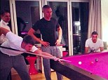 Pretty in pink: Arsenal stars are focused on the pool table