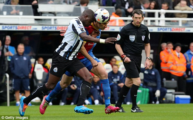 50/50: Moussa Sissoko and Mile Jedinak tussle for possession in the middle of the park