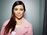 This March 24, 2014 photo shows TV personality and businesswoman Kourtney Kardashian while promoting the new Kardashian Kids clothing line in New York. (Photo by Dan Hallman/Invision/AP)