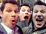 Give us a real smile, Nick! Lachey poses with his mouth agape in series of fan selfies taken over a three week period