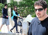 Baby's day out! Jason Biggs and wife Jenny Mollen take five-week-old son Sid for a sunshine stroll