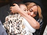 Blue Ivy steals the spotlight from famous parents Beyoncé and Jay Z in her stylish leopard-print fur vest during lunch outing in Barcelona
