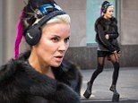 She doesn't want to be pint-sized! Daphne Guinness goes for stroll in favourite heel-less boots with towering platform and fur shrug