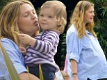 Pregnant Drew Barrymore displays huge baby bump as she plants loving kiss on 17-month-old daughter Olive