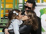 Jessica Alba showers daughter Honor in kisses much to Cash Warren's delight as they enjoy a sweet family outing at a Parisian park