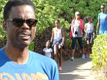 Life's a beach! Chris Rock enjoys some family time with bikini-clad wife and daughters in Hawaii