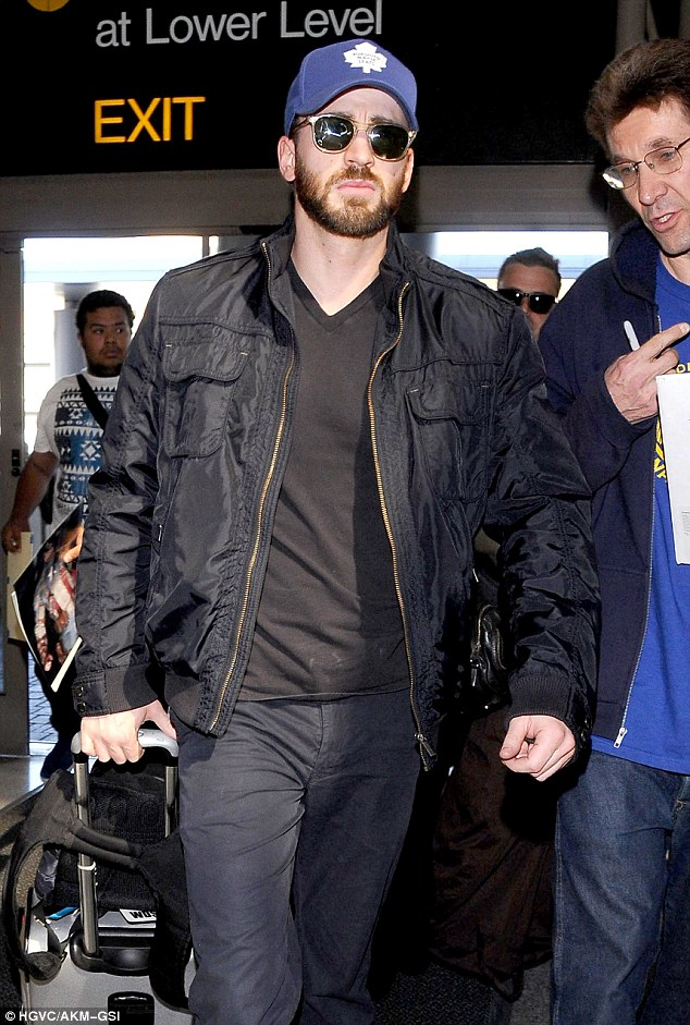 Scruffy: The 32-year-old sported a beard, sunglasses and a purple hat