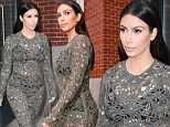 We can see your granny pants! Kim Kardashian shows off her black bra and Bridget Jones-style underwear in a sheer lace dress