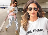 Lily Aldridge wears Kings Of Leon sweater in nod to husband Caleb Followill as she carries giggling daughter Dixie through LAX