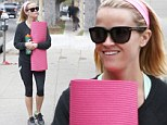 Looking great at 38! A fresh-faced Reese Witherspoon displays her trim and toned physique as she emerges from yoga class