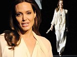 Ray of light! Angelina Jolie glows in ivory pantsuit to promote her film Unbroken at Las Vegas event
