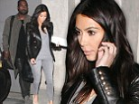 Like magic! Kim Kardashian shaves inches off her already slim figure in head-to-toe grey before catching a flight with Kanye