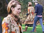 Actress Blake Lively and her husband Ryan Reynolds try to sneak away during a break from filming a scene on the set of Blake's latest project