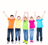 Group of smiling kids with raised hands.