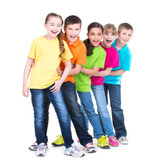 Group of children stand behind each other.