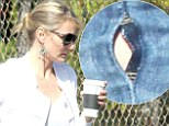 Let her rip! Cameron Diaz bursts out of her VERY skinny jeans that sport a small slit on the side