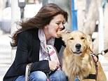 Lisa Vanderpump playfully bites her pet Rumpy Pumpy's ear as they visit trainer but the pooch is not impressed