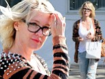 Jennie Garth rocks edgy spiked cardigan and ripped jeans at Byron Williams Salon in Beverly Hills