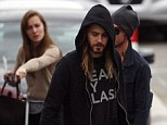 Didn't you pack a change of clothes? Scruffy Jared Leto goes back to his grungy alter ego as he wears favourite T-shirt and hoodie for second time in days