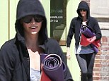 Make-up free Charlize Theron cracks a zen smile following yoga class in West Hollywood