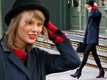 Hold on to your hat! Taylor Swift shows off her long legs in black tights during a windy day in New York